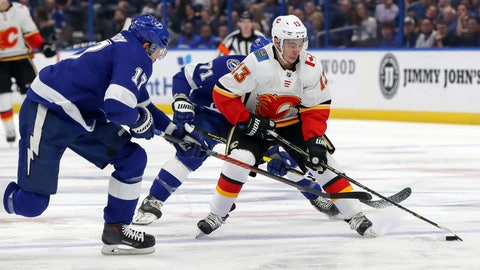 <p>               Calgary Flames' Johnny Gaudreau is checked by Tampa Bay Lightning's Alex Killorn during the first period of an NHL hockey game Tuesday, Feb. 12, 2019, in Tampa, Fla. (AP Photo/Mike Carlson)             </p>