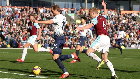 <p>               Tottenham Hotspur's Harry Kane, left, runs in to score his side's first goal of the game against Burnley during their English Premier League soccer match at Turf Moor in  Burnley, England, Saturday Feb. 23, 2019. (Martin Rickett/PA via AP)             </p>