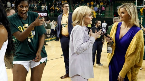 <p>               Baylor's Kalani Brown, left, jokes around while looking at a television camera as coach Kim Mulkey, center, gives an interview after the team's NCAA college basketball game against Kansas in Waco, Texas, Wednesday, Feb. 20, 2019. (AP Photo/Tony Gutierrez)             </p>