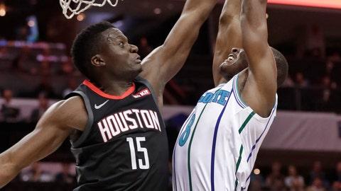 <p>               Houston Rockets' Clint Capela (15) blocks a shot by Charlotte Hornets' Bismack Biyombo (8) during the first half of an NBA basketball game in Charlotte, N.C., Wednesday, Feb. 27, 2019. (AP Photo/Chuck Burton)             </p>