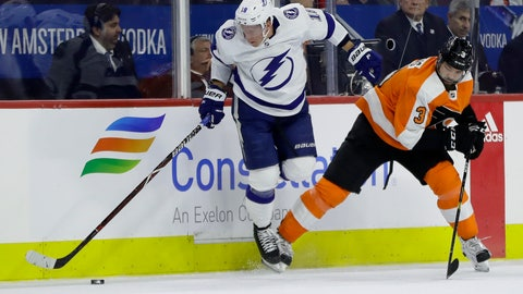 <p>               Tampa Bay Lightning's Ondrej Palat, left, reaches for the puck after a collision with Philadelphia Flyers' Radko Gudas during the second period of an NHL hockey game Tuesday, Feb. 19, 2019, in Philadelphia. (AP Photo/Matt Slocum)             </p>
