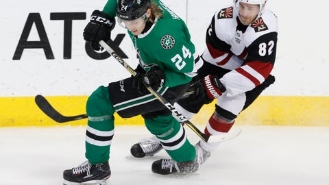 <p>               Dallas Stars left wing Roope Hintz (24) and Arizona Coyotes defenseman Jordan Oesterle (82) skate for the puck during the second period of an NHL hockey game in Dallas, Monday, Feb. 4, 2019. (AP Photo/LM Otero)             </p>