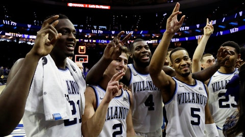 <p>               From left to right, Villanova's Dhamir Cosby-Roundtree, Collin Gillespie, Eric Paschall, Phil Booth and Jermaine Samuels celebrate after an NCAA college basketball game against Georgetown, Sunday, Feb. 3, 2019, in Philadelphia. (AP Photo/Matt Slocum)             </p>
