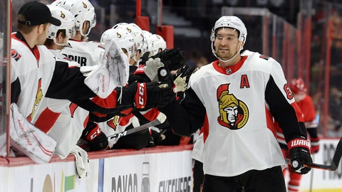<p>               Ottawa Senators right wing Mark Stone (61) celebrates with players on the bench after scoring against the Carolina Hurricanes during the first period of an NHL hockey game, Tuesday, Feb. 12, 2019, in Ottawa, Ontario. (Adrian Wyld/The Canadian Press via AP)             </p>