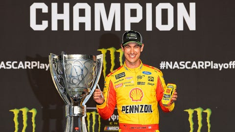 HOMESTEAD, FL - NOVEMBER 18:  Joey Logano, driver of the #22 Shell Pennzoil Ford, celebrates with the trophy after winning the Monster Energy NASCAR Cup Series Ford EcoBoost 400 and the Monster Energy NASCAR Cup Series Championship at Homestead-Miami Speedway on November 18, 2018 in Homestead, Florida.  (Photo by Robert Laberge/Getty Images)