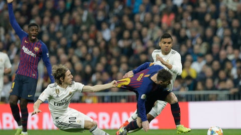 <p>               Barcelona forward Lionel Messi, right, is tackled by Real midfielder Luka Modric during the Copa del Rey semifinal second leg soccer match between Real Madrid and FC Barcelona at the Bernabeu stadium in Madrid, Spain, Wednesday Feb. 27, 2019. (AP Photo/Andrea Comas)             </p>