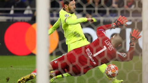 <p>               Barcelona forward Lionel Messi, left, fails to score past Lyon goalkeeper Anthony Lopes, right, during the Champions League round of 16 first leg soccer match between Lyon and FC Barcelona in Decines, near Lyon, central France, Tuesday, Feb. 19, 2019. (AP Photo/Laurent Cipriani)             </p>