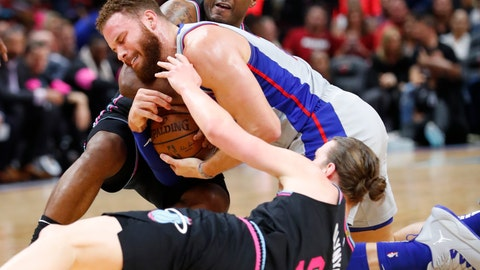 <p>               Miami Heat forward Kelly Olynyk (9) and guard Dion Waiters, rear, battle for the ball with Detroit Pistons forward Blake Griffin, center, during the first half of an NBA basketball game, Saturday, Feb. 23, 2019, in Miami. (AP Photo/Wilfredo Lee)             </p>