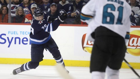<p>               Winnipeg Jets' Patrik Laine (29) blasts a shot during a power play during second period NHL hockey action against the San Jose Sharks, in Winnipeg, Manitoba, Tuesday, Feb. 5, 2019. (Trevor Hagan/The Canadian Press via AP)             </p>