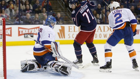 <p>               New York Islanders' Thomas Greiss, left, of Germany, makes a save as teammate Nick Leddy, right, and Columbus Blue Jackets' Josh Anderson look for the rebound during the second period of an NHL hockey game Thursday, Feb. 14, 2019, in Columbus, Ohio. (AP Photo/Jay LaPrete)             </p>