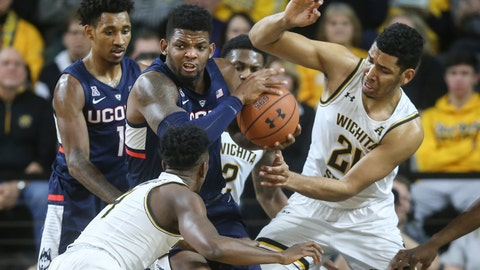 <p>               Connecticut forward Eric Cobb, middle, tries to avoid Wichita State defenders Jaime Echenique, right, and Samajae Haynes-Jones, bottom left, during the first half of an NCAA college basketball game in Wichita, Kan., Thursday, Feb. 28, 2019. (Travis Heying/The Wichita Eagle via AP)             </p>