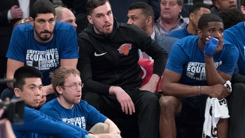 <p>               New York Knicks center Enes Kanter. left, forward Mario Hezonja, center, and guard Damyean Dotson, right, watch the game action from the bench during the first half of an NBA basketball game against the Detroit Pistons, Tuesday, Feb. 5, 2019, at Madison Square Garden in New York. (AP Photo/Mary Altaffer)             </p>