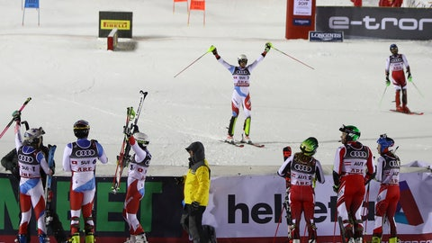 <p>               Switzerland's Ramon Zenhaeusern, center, celebrates as Switzerland wins the team event, at the alpine ski World Championships in Are, Sweden, Tuesday, Feb. 12, 2019. (AP Photo/Alessandro Trovati)             </p>