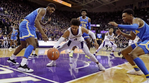 <p>               Washington guard Matisse Thybulle, center, drives between UCLA forward Cody Riley, left, and guard Jaylen Hands, right after making a steal during the first half of an NCAA college basketball game, Saturday, Feb. 2, 2019, in Seattle. (AP Photo/Ted S. Warren)             </p>
