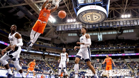 <p>               Virginia Tech's Ahmed Hill (13) dunks between Pittsburgh's Sidy N'Dir, left, and Terrell Brown (21) during the first half of an NCAA college basketball game, Saturday, Feb. 16, 2019, in Pittsburgh. (AP Photo/Keith Srakocic)             </p>