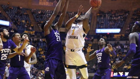 <p>               West Virginia forward Derek Culver (1) shoots while defended by TCU center Kevin Samuel (21) during the second half of an NCAA college basketball game Tuesday, Feb. 26, 2019, in Morgantown, W.Va. (AP Photo/Raymond Thompson)             </p>