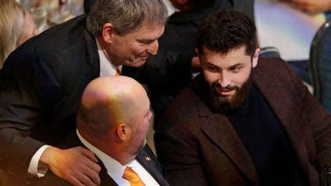 <p>               Former Cleveland Browns quarterback Bernie Kosar, top, talks with quarterback Baker Mayfield, right, and coach Freddie Kitchens at the Cleveland Sports Awards, Wednesday, Feb. 6, 2019, in Cleveland. Mayfield, who finished second to New York Giants running back Saquon Barkley for Offensive Rookie of the Year, is expected to win male athlete of the year at the Cleveland Sports Awards. (AP Photo/Tony Dejak)             </p>