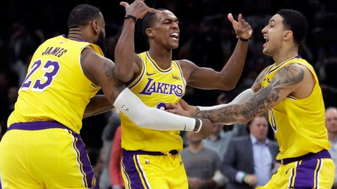 <p>               Los Angeles Lakers guard Rajon Rondo, middle, celebrates his game-winning shot with teammates LeBron James (23) and Kyle Kuzma (0), in an NBA basketball game against the Boston Celtics, Thursday, Feb. 7, 2019, in Boston. The Lakers won 129-128. (AP Photo/Elise Amendola)             </p>