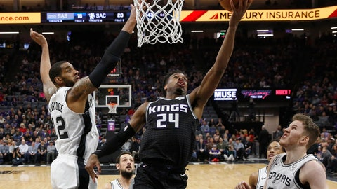 <p>               Sacramento Kings guard Buddy Hield, center, goes to the basket against San Antonio Spurs center LaMarcus Aldridge, left, as Spurs' DeMar DeRozan, second from right, and Jakob Poeltl, right, look on during the first quarter of an NBA basketball game Monday, Feb. 4, 2019, in Sacramento, Calif.(AP Photo/Rich Pedroncelli)             </p>