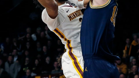 <p>               Minnesota's Jordan Murphy, left, goes for a layup as Michigan's Jon Teske tries to block the shot in the first half of an NCAA college basketball game Thursday, Feb. 21, 2019, in Minneapolis. (AP Photo/Jim Mone)             </p>