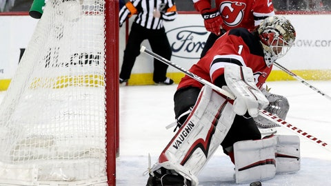 <p>               New Jersey Devils goaltender Keith Kinkaid (1) blocks a shot from the Carolina Hurricanes during the first period of an NHL hockey game, Sunday, Feb. 10, 2019, in Newark, N.J. (AP Photo/Julio Cortez)             </p>