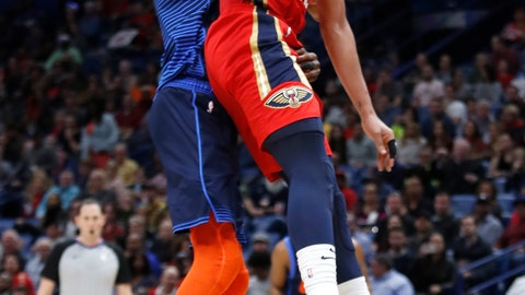 <p>               New Orleans Pelicans forward Anthony Davis (23) collides with Oklahoma City Thunder forward Nerlens Noel (3) after attempting to block a shot at the end of the first half of an NBA basketball game in New Orleans, Thursday, Feb. 14, 2019. Davis kept his left arm still as he walked to the locker room shortly after fouling Noel on an attempted shot block with his left hand. When the second half began, the Pelicans announced that Davis was out of the remainder of the game with a left shoulder injury, The Pelicans won 131-122. (AP Photo/Tyler Kaufman)             </p>