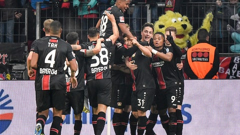 <p>               Leverkusen's Kevin Volland, 4th from right, is celebrated by his team after he scored his side's second goal during the German Bundesliga soccer match between Bayer 04 Leverkusen and FC Bayern Munich in Leverkusen, Germany, Saturday, Feb. 2, 2019. (AP Photo/Martin Meissner)             </p>