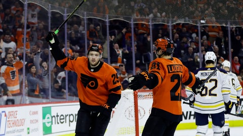 <p>               Philadelphia Flyers' James van Riemsdyk (25) celebrates with Scott Laughton (21) after scoring a goal during the second period of an NHL hockey game against the Buffalo Sabres, Tuesday, Feb. 26, 2019, in Philadelphia. (AP Photo/Matt Slocum)             </p>