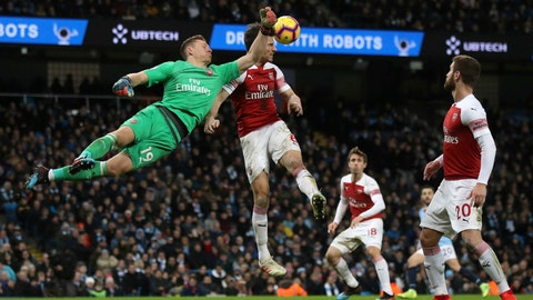 <p>               Arsenal goalkeeper Bernd Leno blocks a Manchester City shot, during their English Premier League soccer match at the Etihad Stadium in Manchester, England, Sunday Feb. 3, 2019. (Nick Potts/PA via AP)             </p>