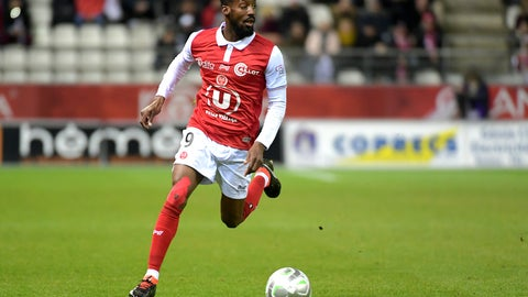"<p>               FILE - In this March 9, 2018, file photo, Reims' Anatole Ngamukol controls the ball during a league II soccer match against Chateauroux in Reims, eastern France. French soccer players are turning to the courts to fight workplace bullying and the practice known in France by an English word, ""le loft."" (AP Photo/Christian Lantenois, File)             </p>"