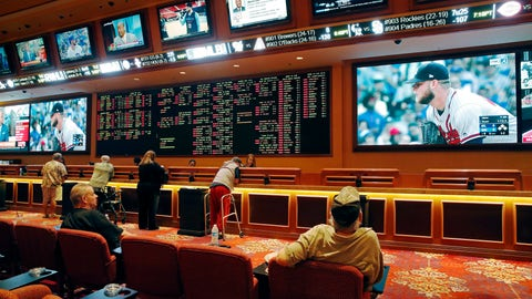 <p>               FILE - In this May 14, 2018, file photo, people make bets in the sports book at the South Point hotel and casino in Las Vegas. Las Vegas is not worried about the competition from casinos in other states that for the first time Sunday, Feb. 3, 2019, will also offer football fans a chance to bet on the Super Bowl. The weekend is worth hundreds of millions of dollars to the city, which draws tens of thousands of people for the big game's weekend. (AP Photo/John Locher, File)             </p>