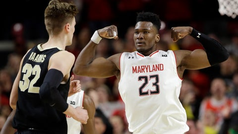 <p>               Maryland forward Bruno Fernando (23) gestures in front of Purdue center Matt Haarms during the second half of an NCAA college basketball game Tuesday, Feb. 12, 2019, in College Park, Md. Fernando contributed 12 points to Maryland's 70-56 win. (AP Photo/Patrick Semansky)             </p>