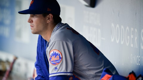 "<p>               FILE - In this Sept. 3, 2018, file photo, New York Mets' Jacob deGrom watches from the dugout prior to the team's baseball game against the Los Angeles Dodgers in Los Angeles. NL Cy Young winner deGrom wants to hear the Mets' best pitch on a multiyear contract by opening day--and the team thinks that's a good call, too. New general manager Brodie Van Wagenen, who was deGrom's agent before switching sides at the bargaining table last fall, told reporters Tuesday, Feb. 12, at spring training there's ""no reason for a distraction to carry into the regular season."" (AP Photo/Kelvin Kuo, File)             </p>"