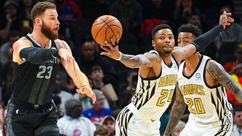 <p>               Atlanta Hawks guard Kent Bazemore (24) gets his hand on a pass by Detroit Pistons forward Blake Griffin (23) for a steal during the first half of an NBA basketball game, Friday, Feb. 22, 2019, in Atlanta. (AP Photo/John Amis)             </p>