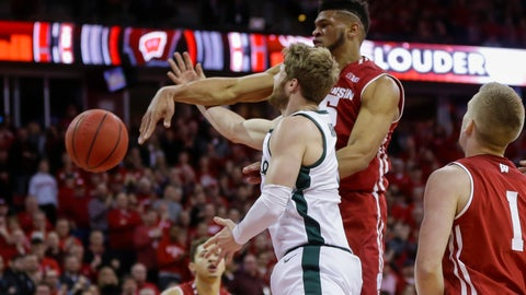 <p>               Wisconsin's Charles Thomas (15) blocks a a shot by Michigan States's Kyle Ahrens (0) during the first half of an NCAA college basketball game Tuesday, Feb. 12, 2019, in Madison, Wis. (AP Photo/Andy Manis)             </p>