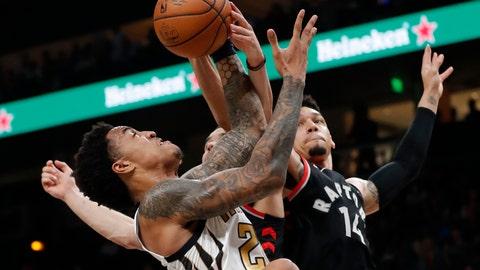 <p>               Atlanta Hawks forward John Collins (20) and Toronto Raptors guard Danny Green (14) battle for a rebound during the first half of an NBA basketball Thursday, Feb. 7, 2019, in Atlanta. (AP Photo/John Bazemore)             </p>