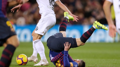 <p>               FC Barcelona's Lionel Messi falls during the Spanish La Liga soccer match between FC Barcelona and Valencia at the Camp Nou stadium in Barcelona, Spain, Saturday, Feb. 2, 2019. (AP Photo/Manu Fernandez)             </p>