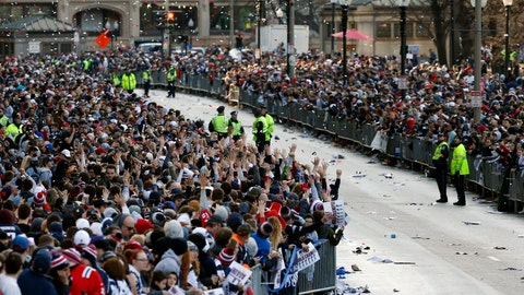 <p>               Fans line Tremont Street before the New England Patriots parade through downtown Boston, Tuesday, Feb. 5, 2019, to celebrate their win over the Los Angeles Rams in Sunday's NFL Super Bowl 53 football game in Atlanta. (AP Photo/Michael Dwyer)             </p>