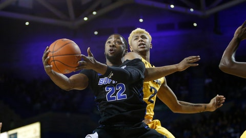 <p>               Buffalo guard Dontay Caruthers (22) lays up the ball past Kent State BJ Duling (2) during the first half of an NCAA college basketball game, Friday, Feb. 22, 2019, in Buffalo N.Y. (AP Photo/Jeffrey T. Barnes)             </p>