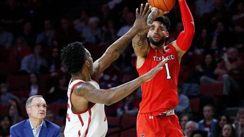 <p>               Texas Tech guard Brandone Francis (1) shoots as Oklahoma forward Kristian Doolittle, left, defends, in the first half of an NCAA college basketball game in Norman, Okla., Saturday, Feb. 9, 2019. (AP Photo/Sue Ogrocki)             </p>