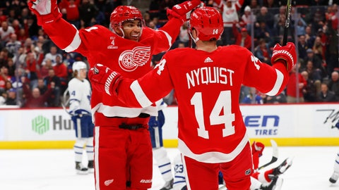 <p>               Detroit Red Wings right wing Gustav Nyquist (14) celebrates his goal with Andreas Athanasiou in the second period of an NHL hockey game against the Toronto Maple Leafs, Friday, Feb. 1, 2019, in Detroit. (AP Photo/Paul Sancya)             </p>