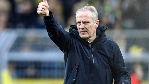 <p>               FILE - In this Saturday, Dec. 1, 2018 photo Freiburg head coach Christian Streich gestures during the German Bundesliga soccer match between Borussia Dortmund and SC Freiburg in Dortmund, Germany.  Christian Streich, the longest serving coach in the Bundesliga and one of its most charismatic, is staying on in charge of Freiburg. The modest club from the southwest of Germany extended the 53-year-old's contract this week, ensuring he and his training team of four assistants will remain in position beyond the end of the season, regardless of how it ends. (AP Photo/Martin Meissner, file)             </p>