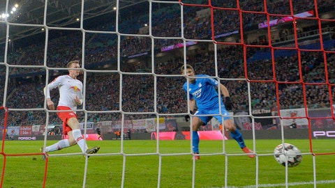 <p>               Hoffenheim's Andrej Kramaric scores the opening goal, right, during the German first division Bundesliga soccer match between RB Leipzig and TSG 1899 Hoffenheim in Leipzig, Germany, Monday, Feb. 25, 2019. (AP Photo/Jens Meyer)             </p>