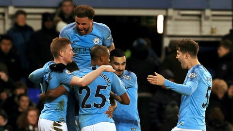 <p>               Manchester City's Gabriel Jesus, obscured, celebrates with teammates after scoring his side's second goal of the game against Everton during an English Premier League soccer match at Goodison Park, Liverpool, England, Wednesday, Feb. 6, 2019. (Peter Byrne/PA via AP)             </p>