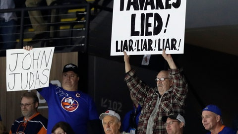 <p>               New York Islanders fans express their sentiments toward Toronto Maple Leafs center John Tavares, who left for Toronto in the offseason after saying he would stay with the Islanders, during the first period of an NHL hockey game between the teams Thursday, Feb. 28, 2019, in Uniondale, N.Y. (AP Photo/Kathy Willens)             </p>