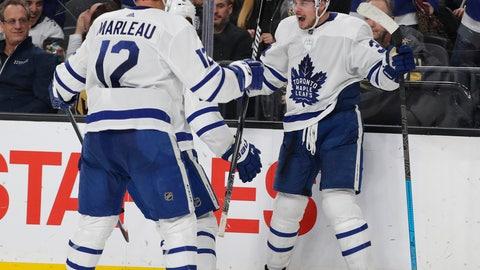 <p>               Toronto Maple Leafs center Auston Matthews, right, celebrates after scoring against the Vegas Golden Knights during the third period of an NHL hockey game Thursday, Feb. 14, 2019, in Las Vegas. (AP Photo/John Locher)             </p>