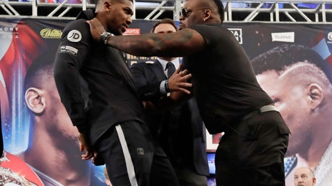 <p>               British boxer Anthony Joshua, left, is shoved by Jarrell Miller, right, as they pose for photographs during a news conference Tuesday, Feb. 19, 2019, in New York, to promote their upcoming fight. (AP Photo/Frank Franklin II)             </p>