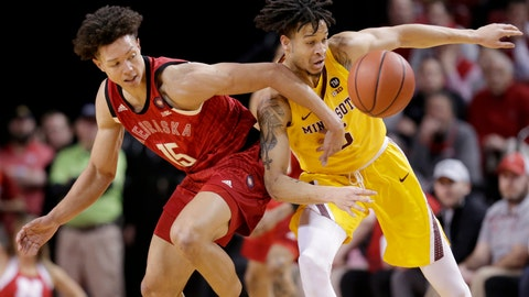 <p>               Minnesota's Amir Coffey (5) fouls Nebraska's Isaiah Roby (15) during the first half of an NCAA college basketball game in Lincoln, Neb., Wednesday, Feb. 13, 2019. (AP Photo/Nati Harnik)             </p>