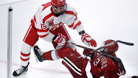 <p>               Harvard defenseman Jack Rathbone, right, is checked to the ice by Boston University forward Shane Bowers, left, during the third period of the consolation game of the NCAA hockey Beanpot tournament in Boston, Monday, Feb. 11, 2019. (AP Photo/Charles Krupa)             </p>