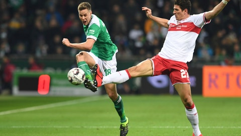 <p>               Werder's Niklas Moisander, left, battles against Stuttgart's Mario Gomez for the ball during the German Bundesliga soccer match between Werder Bremen and VfB Stuttgart in Bremen, Germany, Friday, Feb. 22, 2019. (Carmen Jaspersen/dpa via AP)             </p>